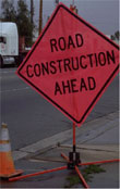 Red, diamond Road Construction Ahead sign